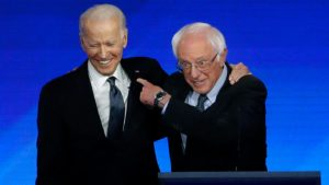 Joe Biden, Bernie Sanders spar over long records on trade, entitlements, guns and Iraq as primaries push on